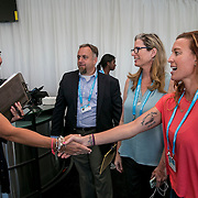 August 22, 2016, New Haven, Connecticut: <br /> Tournament Director Anne Worcester greets ESPNW reporter Jane McManus and former Olympian Brooke Bennett during the Anthem Symposium during Day 4 of the 2016 Connecticut Open at the Yale University Tennis Center on Monday August  22, 2016 in New Haven, Connecticut. <br /> (Photo by Billie Weiss/Connecticut Open)
