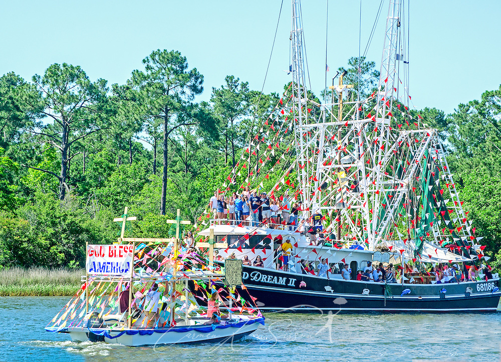 Decorated shrimp boats participate in the 66th annual Blessing of the Fleet in Bayou La Batre, Alabama, May 3, 2015. The first fleet blessing was held by St. Margaret's Catholic Church in 1949, carrying on a long European tradition of asking God's favor for a bountiful seafood harvest and protection from the perils of the sea. The highlight of the event is a blessing of the boats by the local Catholic archbishop and the tossing of a ceremonial wreath in memory of those who have lost their lives at sea. The event also includes a land parade and a parade of decorated boats that slowly cruise through the bayou. (Photo by Carmen K. Sisson/Cloudybright)
