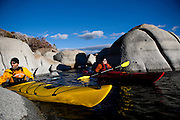 Harry King, left, and Julio Ayala, right, kayak on Lake Tahoe near Kings Beach, Calif., January 19, 2011.