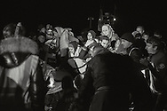 Migrants panic leaving their boat as dead passengers are discovered aboard. Lesbos, March 20, 2016.