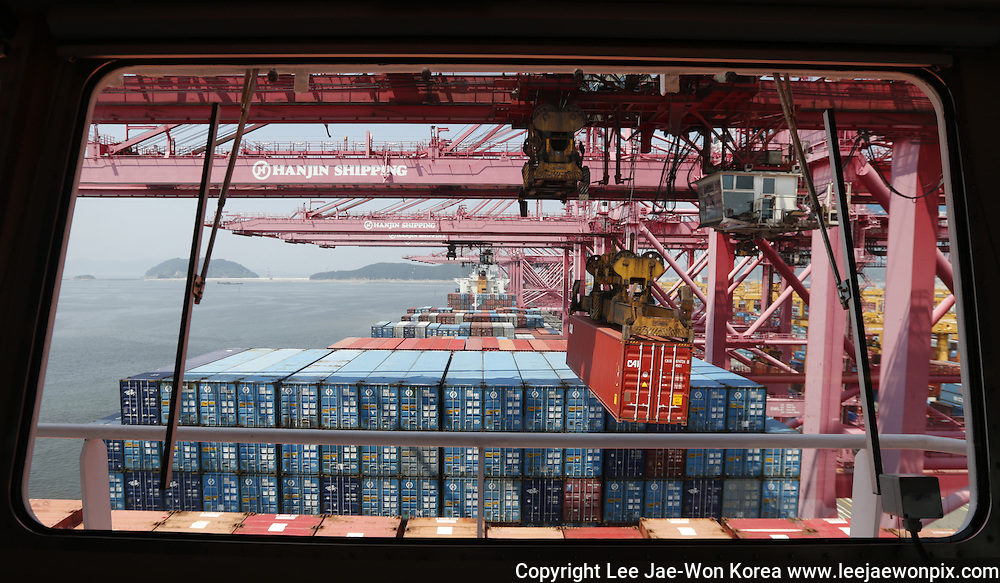 A crane carries a container from a ship of Hanjin Shipping at Hanjin container terminal at the Busan New Port in Busan, about 420 km (261 miles) southeast of Seoul. Photo by Lee Jae-Won (SOUTH KOREA) www.leejaewonpix.com/