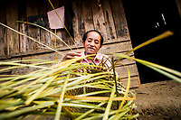 Wa Meng Ha goes about his daily chores at his home in Khon Kahndone Village, Xieng Khouang province, Laos.