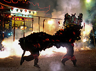 Firecrackers explode while lion dancers performing at the Thien Hau temple to celebrate the first day of the Chinese Lunar New Year, the Year of the Dog, on Friday February 16, 2018, in Los Angeles, the United States. (Xinhua/Zhao Hanrong)<br /> 2月16日,农历正月初一凌晨,在美国洛杉矶,大批华人涌入中国城天后宫庙上香祈福。图为民众在庙前烧炮舞狮。新华社发 (赵汉荣摄) (Photo by Ringo Chiu)<br /> <br /> Usage Notes: This content is intended for editorial use only. For other uses, additional clearances may be required.