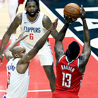 28 February 2018: Houston Rockets guard James Harden (13) takes a jump shot over LA Clippers guard C.J. Williams (9) during the Houston Rockets 105-92 victory over the LA Clippers, at the Staples Center, Los Angeles, California, USA.