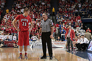Dixie Heights' Zeke Pike, left, talks with an official during a foul shot in the second half. Lexington Catholic hosted Dixie Heights in the 2011 PNC/ KHSAA Boys Sweet 16, Wednesday, March 16, 2011.