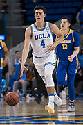 UCLA Bruins guard Jaime Jaquez Jr. (4) starts a fast break with San Jose State Spartans forward Eduardo Lane (12) trailing during an NCAA college basketball game, Sunday, Dec. 1, 2019, in Los Angeles. UCLA defeated San Jose State 93-64. (Jon Endow/Image of Sport)