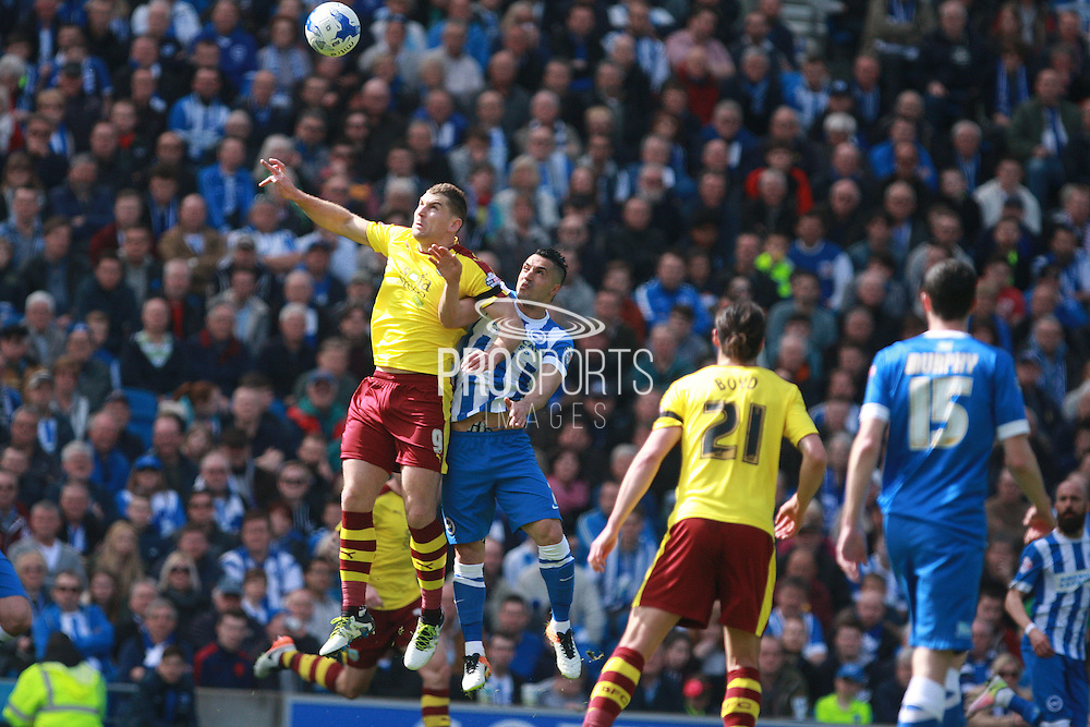Burnley striker Sam Vokes & Brighton central midfielder Beram Kayal compete for a high ball during the Sky Bet Championship match between Brighton and Hove Albion and Burnley at the American Express Community Stadium, Brighton and Hove, England on 2 April 2016. Photo by Bennett Dean.