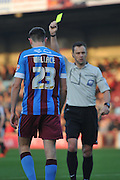 yellow card for Murray Wallace of Scunthorpe United during the Sky Bet League 1 match between Scunthorpe United and Barnsley at Glanford Park, Scunthorpe, England on 31 October 2015. Photo by Ian Lyall.