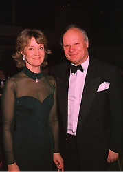 MR & MRS JEREMY PALMER-TOMKINSON at a ball in London on 4th March 1998.MFY 22