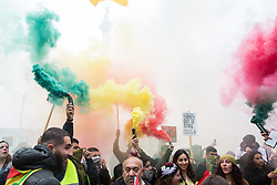 London, UK. 13 October, 2019. Kurdish supporters of the YPG march with smoke grenades in protest against Turkey's invasion of Kurdish-held territory in north-eastern Syria.