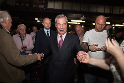 """© Licensed to London News Pictures . 25/05/2016 . Bolton , UK . NIGEL FARAGE takes to the stage to speak . Nigel Farage , Kate Hoey and Paul Nuttall at a """" We Want Our Country Back """" public meeting in favour of the UK leaving the EU at the Premier Suite of Bolton Wanderers' Macron Stadium . Photo credit : Joel Goodman/LNP"""