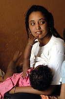 Niger,Agadez,2007. Jamila Ixa breastfeeds in the coolness of the big room at Mohammad Ixa's family home.