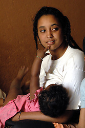 Niger,Agadez,2007. Jamila Ixa breastfeeds in the coolness of the big room at Mohammad Ixa's family home.