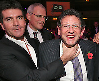 Left to Right Simon Cowell, Vivendi CEO Jean-Bernard Lévy, Lucian Grainge (MIT Awards recipient and Universal Music Group International Chairman/CEO) Simon Fuller (chief executive, 19 Entertainment)