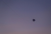 Flying a kite during sunset at Kayu Putih beach in Canggu.