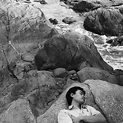 A Vietnamese engineer naps on a set of rocks near the Kaman River, Laos. Projected for completion in the end of 2008, the Kaman River dam project is expected to flood large sections of the legendary Ho Chi Minh Trail in Laos.