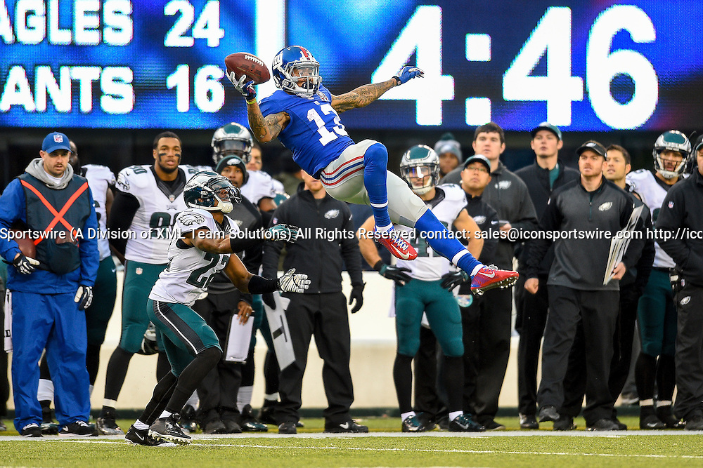 December 28, 2014: New York Giants wide receiver Odell Beckham (13) pulls in a one handed catch as Philadelphia Eagles cornerback Brandon Boykin (22) looks on during the second half of a NFL Eastern matchup between the Philadelphia Eagles and the New York Giants at MetLife Stadium in East Rutherford, New Jersey. the Eagles defeated the Giants 34-26.