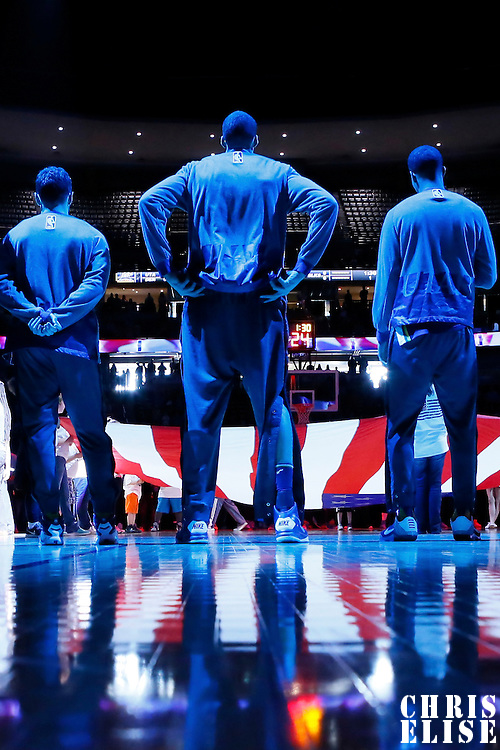 10 April 2016: Utah Jazz players stand during the national anthem prior to the Utah Jazz 100-84 victory over the Denver Nuggets, at the Pepsi Center, Denver, Colorado, USA.
