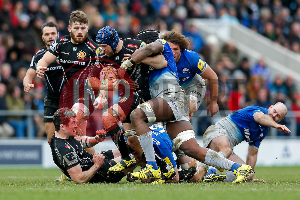 Exeter Chiefs Flanker Julian Salvi is tackled by Saracens replacement Maro Itoje - Mandatory byline: Rogan Thomson/JMP - 07/02/2016 - RUGBY UNION - Sandy Park - Exeter, England - Exeter Chiefs v Saracens - Aviva Premiership.