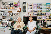 Mr. Muneyoshi Kayoh and his wife, Yoshiko, in their home. Muneyoshi, 93 years old, is a retired veteran and farmer. He is a popular figure among protesters in Henoko and is affectionately called &lsquo;Grandpa Kayoh&rsquo;. Originally from Henoko, he has witnessed changes in the environment where he lives: pond snails, geckos, black shrimp, and crabs have all disappeared since his childhood days. <br /> <br /> In 1942, at the age of 19, he was enlisted in the Japanese Navy and was stationed at Cam Ranh Bay in French Indochina (Vietnam). His experience with war has affected his view of military bases. He wants to see all military bases out of Okinawa. He is worried about the impact of pesticides and oil on the environment. It was reported that there were &lsquo;burning water wells&rsquo; in the Kadena area, because well water was contaminated by a jet fuel leak from the Kadena U.S. Airbase in 1967. The soil, he says, was also contaminated with Agent Orange in Camp Schwab.<br /> <br /> There is a local saying that says anyone who lives to the age of 90 is lucky and therefore no longer needs to live longer. However, Mr. Kayoh says he is unable to rest until the problems of Henoko are resolved.