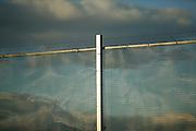 Metal mesh fencing.