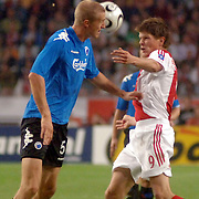 NLD/Amsterdam/20060823 - Ajax - FC Kopenhagen, duel Klaas Jan Huntelaar en Brede Hangeland