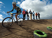 PRICE CHAMBERS / NEWS&amp;GUIDE<br /> Sam Krieg speeds by spectators at the 2011 Moose Cross in Victor's Pioneer Park on Sunday, rounding out a weekend of racing through the dirt trails as he takes third place in the Men's 1-2-3 category.