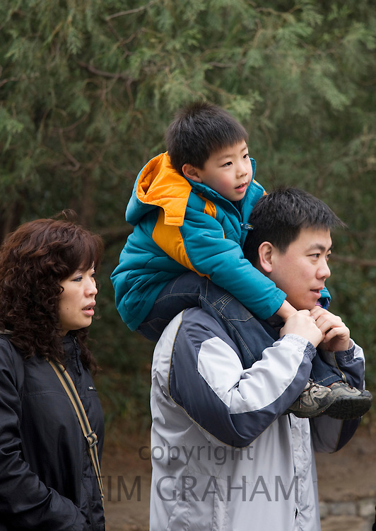 Family at The Summer Palace, Beijing. China has a one child family planning policy to limit population.