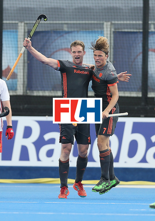 LONDON, ENGLAND - JUNE 24:  Mirco Pruijser of the Netherlands celebrates scoring their teams first goal with teammates during the semi-final match between England and the Netherlands on day eight of the Hero Hockey World League Semi-Final at Lee Valley Hockey and Tennis Centre on June 24, 2017 in London, England.  (Photo by Alex Morton/Getty Images)