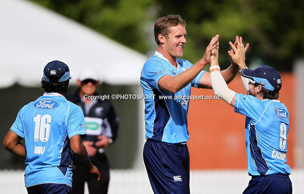 Michael Bates celebrates with Craig Cachopa after a wicket. Auckland Aces v Wellington Firebirds, Ford Trophy one day game held at Burt Sutcliffe Oval, Lincoln, Friday 25 November 2011. Photo : Joseph Johnson / photosport.co.nz