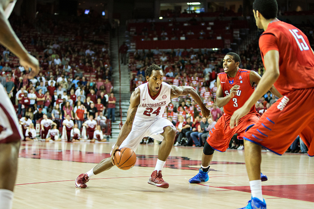 FAYETTEVILLE, AR - NOVEMBER 18:  Michael Qualls #24 of the Arkansas Razorbacks drives to the basket against the SMU Mustangs at Bud Walton Arena on November 18, 2013 in Fayetteville, Arkansas.  The Razorbacks defeated the Mustangs 89-78.  (Photo by Wesley Hitt/Getty Images) *** Local Caption *** Michael Qualls