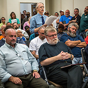 WALDORF, MD - AUG20: Jim Long, President of the Mattawoman Watershed Society, makes public comments against the proposed gas-fired power plant to the Maryland Public Service Commission, August 20, 2015, at the Charles County Public Library in Waldorf, Maryland. The plant would become the fifth plant in a 13-mile radius in southern Maryland and drew a standing room only crowd to comment on the record. (Photo by Evelyn Hockstein/For The Washington Post)