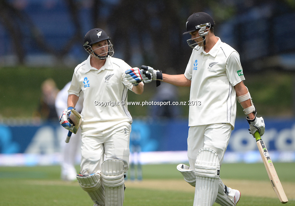Record 10th wicket partnership between BJ Watling and Trent Boult on Day 2 of the 2nd cricket test match of the ANZ Test Series. New Zealand Black Caps v West Indies at The Basin Reserve in Wellington. Thursday 12 December 2013. Mandatory Photo Credit: Andrew Cornaga www.Photosport.co.nz