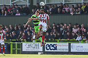 Forest Green Rovers Paul Digby(20) and Cheltenham Town's Tyrone Barnett(29) jump for the ball during the EFL Sky Bet League 2 match between Forest Green Rovers and Cheltenham Town at the New Lawn, Forest Green, United Kingdom on 20 October 2018.