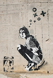 Stenciled street art by prominent artist xoooox in Berlin Germany