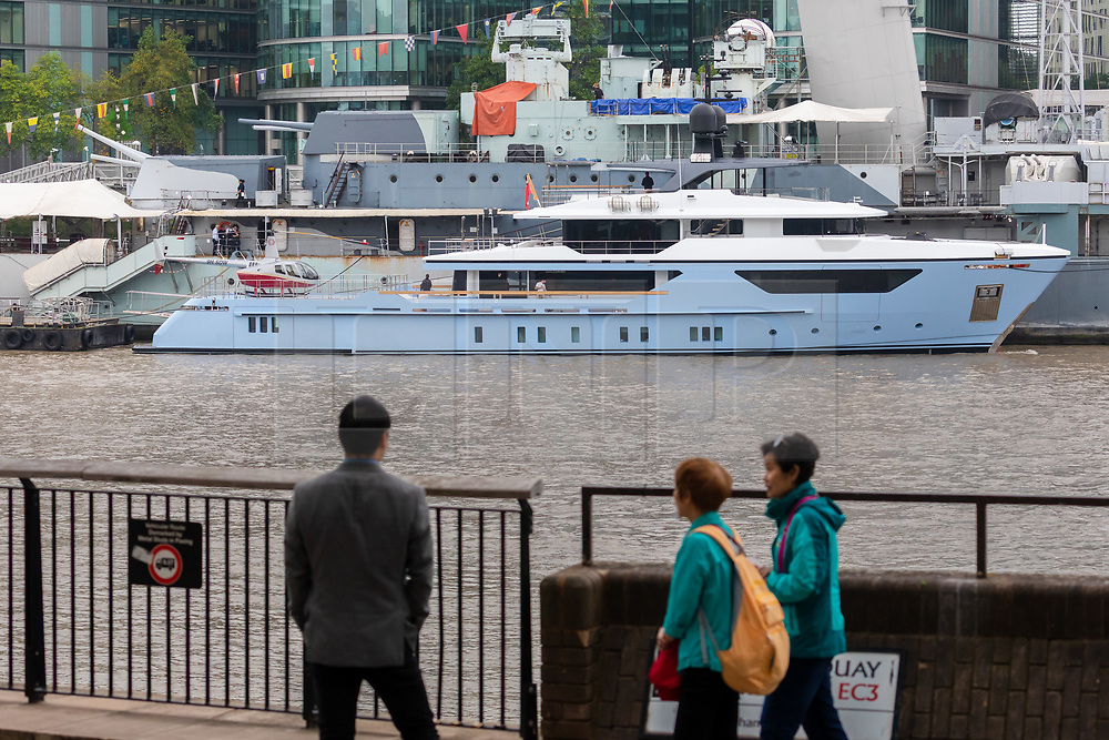 © Licensed to London News Pictures. 16/09/2019. London, UK. Passers by on the Thames Path look at luxury superyacht Ocean Dreamwalker III moors next to HMS Belfast on the River Thames, seen with a helicopter on the helipad at the stern of the yacht during a London visit. 155 feet long long Ocean Dreamwalker III was built in 2018 and is rumoured to be owned by John Deng, a Chinese entrepreneur and politician. It is believed that this is the first time a superyacht has visited the capital with a helicopter onboard. Photo credit: Vickie Flores/LNP