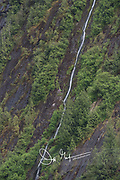 A Waterfall rushes down the mountainside at Misty Fiords National Monument, Alaska