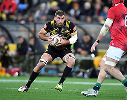"""Callum Gibbons of the Hurricanes steps James Haskell of the Lions in the International rugby match between the the Super Rugby Hurricanes and British and Irish Lions at Westpac Stadium, Wellington, New Zealand, Tuesday, June 27, 2017. Credit:SNPA / Ross Setford  **NO ARCHIVING"""""""