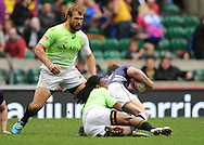 LONDON, ENGLAND - Saturday 10 May 2014, Frankie Horne of South Africa watches as Branco Du Preez tackles a Scottish player during the match between South Africa and Scotland at the Marriott London Sevens rugby tournament being held at Twickenham Rugby Stadium in London as part of the HSBC Sevens World Series.<br /> Photo by Roger Sedres/ImageSA