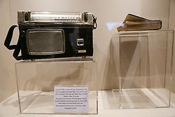 November 9, 2016 - Ramallah, West Bank, Palestinian Territory - A picture shows Holy Quran and transistor radio belonging to Yasser arafat at the late Palestinian leader Yasser Arafat's Museum in the West Bank city of Ramallah on November 9, 2016. The Yasser Arafat Museum opened in Ramallah, shedding light on the long-time Palestinian leader's life and offering a glimpse of history -- along with a number of his trademark black-and-white keffiyehs  (Credit Image: © Shadi Hatem/APA Images via ZUMA Wire)