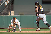 San Francisco Giants second baseman Joe Panik (12) scoops up a ground ball to get Pittsburgh Pirates first baseman John Jaso (28) out at second base at AT&T Park in San Francisco, Calif., on August 17, 2016. (Stan Olszewski/Special to S.F. Examiner)