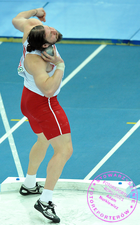 TOMASZ MAJEWSKI (POLAND) COMPETES IN SHOT PUT MEN AT OVAL LINGOTTO HALL DURING EUROPEAN ATHLETICS INDOOR CHAMPIONSHIPS TORINO 2009...TORINO , ITALY , MARCH 07, 2009..( PHOTO BY ADAM NURKIEWICZ / MEDIASPORT )
