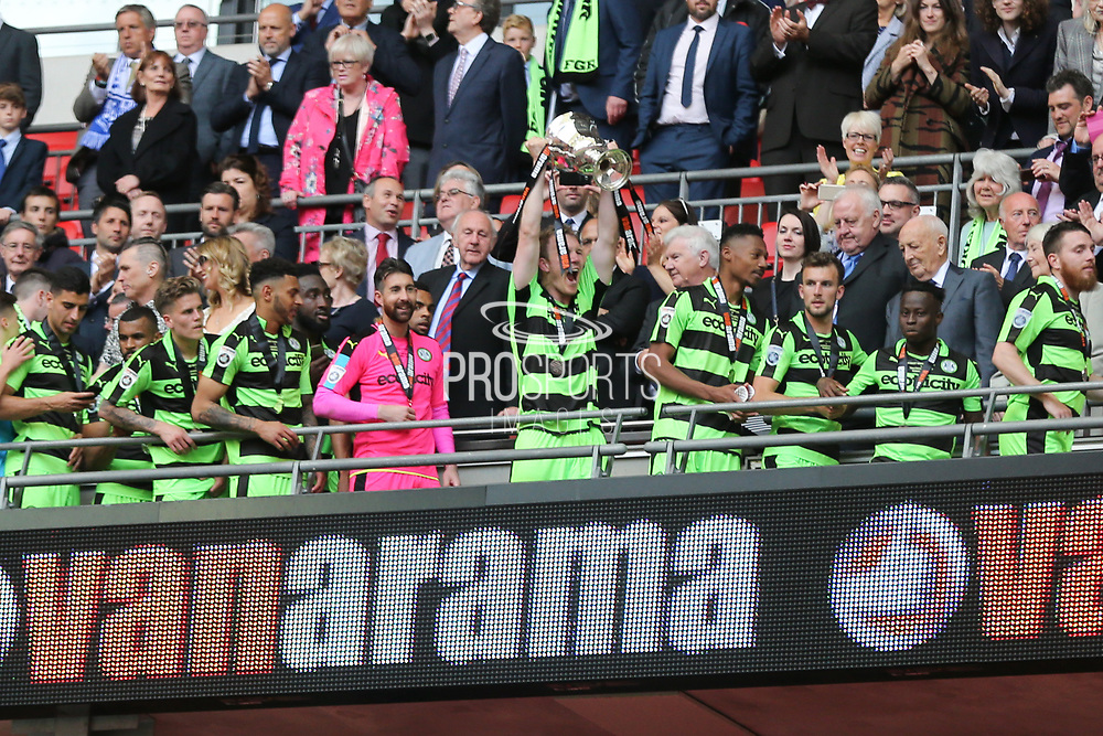 Forest Green Rovers Mark Ellis(5) lifts the trophy during the Vanarama National League Play Off Final match between Tranmere Rovers and Forest Green Rovers at Wembley Stadium, London, England on 14 May 2017. Photo by Shane Healey.