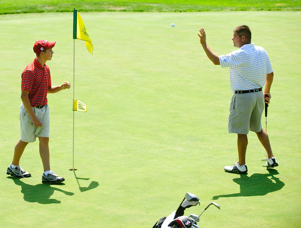 (staff photo by Matt Roth)..during the Rolling Road Club championship semifinals Saturday, September 5, 2009. ..Rick Sovero defeated Ryan Fields after 23 holes of golf...Matt Bassler, the current Maryland Open Champion,.Steve Homans