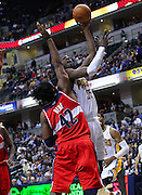 March 29, 2012; Indianapolis, IN, USA; Indiana Pacers center Roy Hibbert (55) shoots over Washington Wizards center Nene (42) at Bankers Life Fieldhouse. Indiana defeated Washington 93-89. Mandatory credit: Michael Hickey-US PRESSWIRE