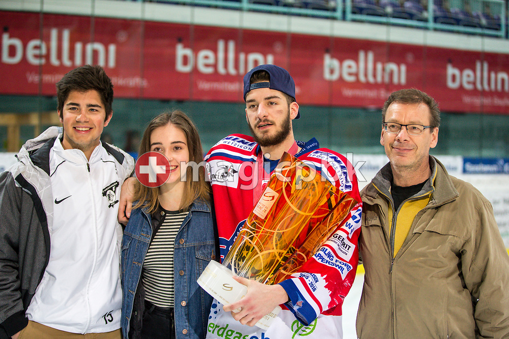 Rapperswil-Jona Lakers defenseman Joel Brotzge poses for a photo with his gold medal and the Swiss Champion trophy after winning the fifth Elite B Playoff Final ice hockey game between Rapperswil-Jona Lakers and ZSC Lions held at the SGKB Arena in Rapperswil, Switzerland, Sunday, Mar. 19, 2017. (Photo by Patrick B. Kraemer / MAGICPBK)