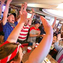 Members of the American Outlaws Boise Chapter #117, a U. S. soccer supporters group cheer as U.S. player Abby Wambach scores what would be the eventual winning goal during the first half of the Women's World Cup game against Nigeria. USA defeated Nigeria 1-0.  Tuesday June 16, 2015