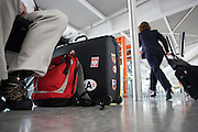 Passenger's baggage and rushing airline employee at Heathrow airport's terminal 5.