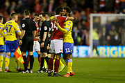 Nottingham Forest defender Caludio Jacob and Leeds United forward Tyler Roberts (11) embrace at full time during the EFL Sky Bet Championship match between Nottingham Forest and Leeds United at the City Ground, Nottingham, England on 1 January 2019.