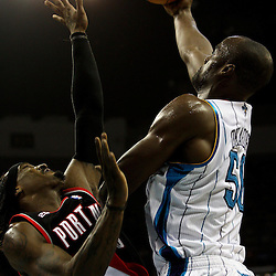 March 30, 2011; New Orleans, LA, USA; New Orleans Hornets center Emeka Okafor (50) shoots over Portland Trail Blazers small forward Gerald Wallace (3) during the first half at the New Orleans Arena.    Mandatory Credit: Derick E. Hingle